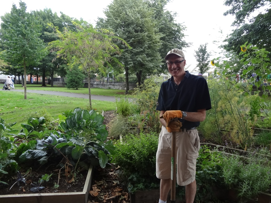 Derec tending one of the raised beds.