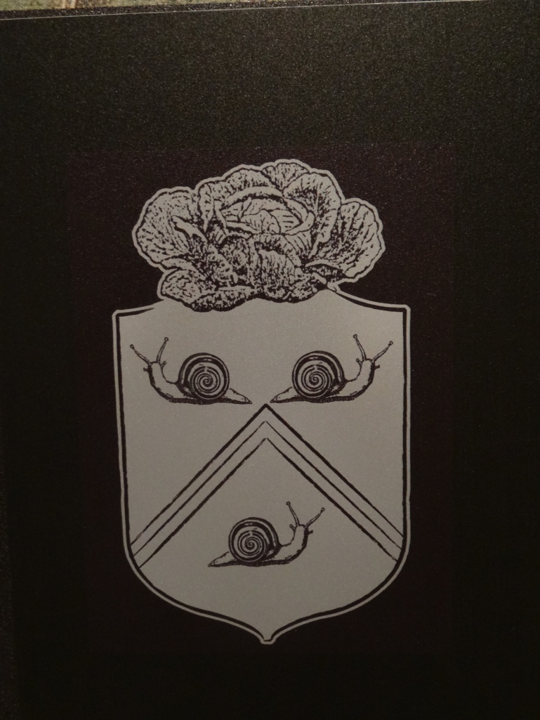 Le Notre's coat of arms, complete with cabbage and slugs.