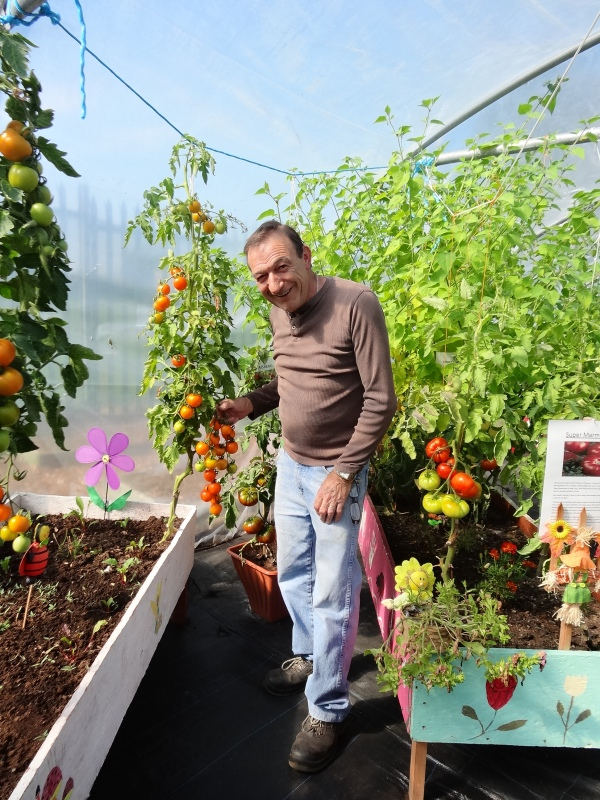 Hubert shares his years of gardening experience with WALK service users and pupils at Scoil Colm.
