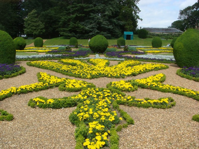 Parterre garden  infilled with flowers, with box balls
