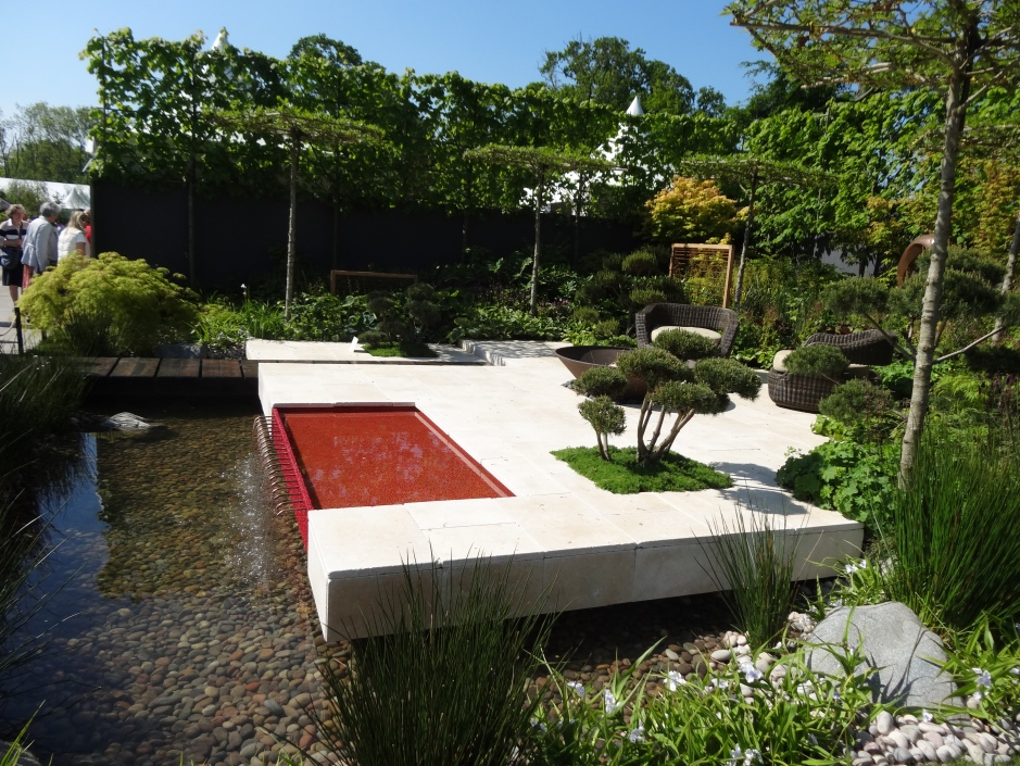 A cloud pruned plant adds interest to the terraced area of this Show Garden.