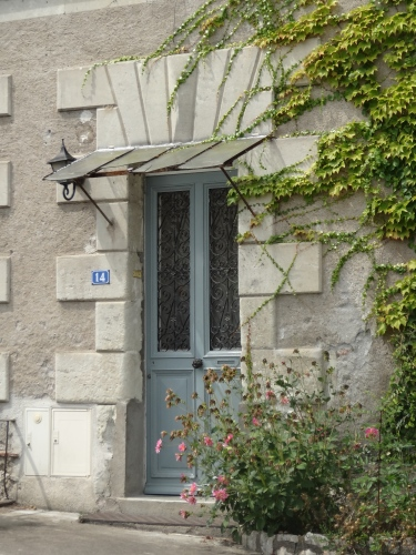 Blue-gray paintwork on a French door. Try filante.com for French style numbers.