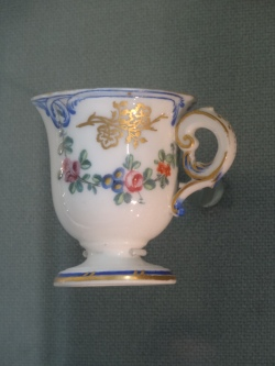 Porcelain cup on Marie Antoinette's colours.