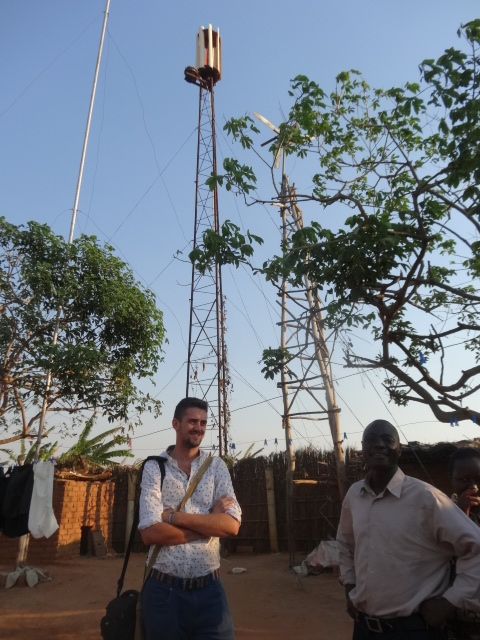 Pádraic MacOireachtaigh with Mr Zawanda, a teacher from Kasungu in front of the new windmills.