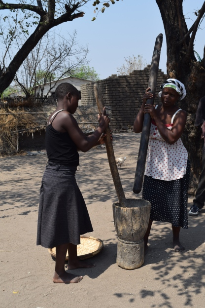 Grinding corn in Chipoka village