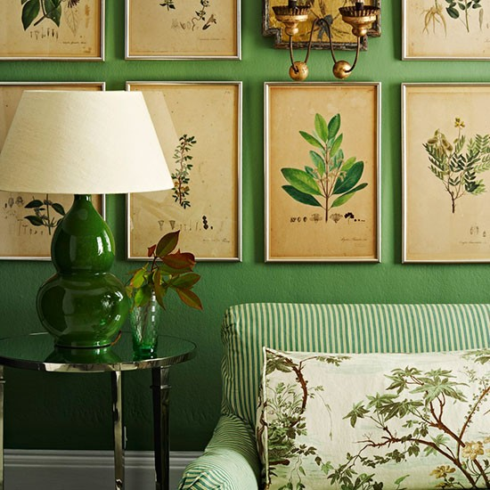green-living-room-with-framed-prints